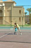 Girl and mother playing tennis Royalty Free Stock Images