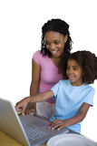 Girl with mother pointing to screen of laptop computer, smiling, cut out Stock Photography