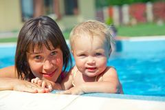 Girl with mother in the pool Royalty Free Stock Photos