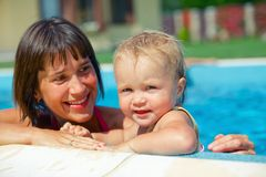 Girl with mother in the pool Stock Photography