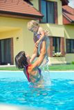 Girl with mother in the pool Stock Images