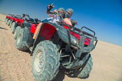 Girl with mother posing on ATV Stock Images