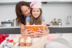 Girl and mother preparing cookies in kitchen Royalty Free Stock Images