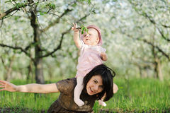 Girl on Mother's Neck Royalty Free Stock Image