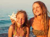 Girl with mother on sea background Royalty Free Stock Image