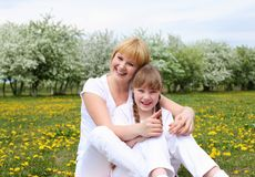 Girl with mother in spring park Royalty Free Stock Images