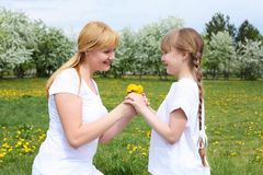 Girl with mother in spring park Stock Image