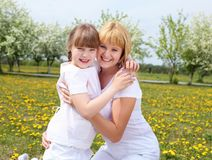 Girl with mother in spring park Stock Photos
