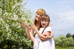 Girl with mother in spring park Royalty Free Stock Photography