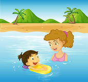 Girl and mother swimming in the sea Stock Image