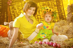 Girl with mother in the village Royalty Free Stock Image