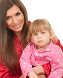 Girl with mother in white bedding Stock Photos