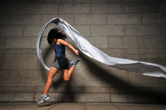 Girl in Motion 7. Pictures of people swirling fabric in motion. Useful for context on creativity or artistic expression or freeze motion Stock Images