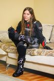 Girl in Moto gear. Leather pants and leather jacket, gloves and. Boots royalty free stock photo