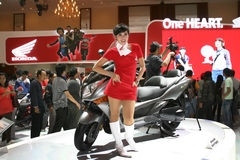 Girl on motor cycle show Royalty Free Stock Images