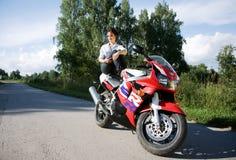 Girl with motorbike Stock Image