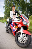 Girl with motorbike Royalty Free Stock Images