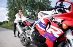 Girl with motorbike Stock Photo
