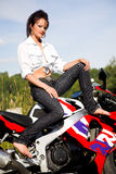 Girl with motorbike Royalty Free Stock Image