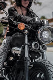 Girl & motorbike closeup Royalty Free Stock Image