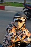 Girl on motorbike in mask Royalty Free Stock Images