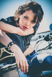 Girl on motorbike Royalty Free Stock Images