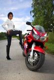 Girl with motorbire Stock Photography