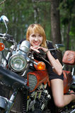 Girl on motorcycle Royalty Free Stock Photography