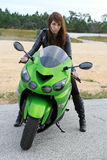 A girl on the motorcycle Royalty Free Stock Image