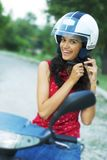 Girl on motorcycle Royalty Free Stock Image