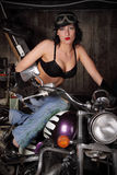 Girl on a motorcycle. The beautiful sexual girl sits on a motorcycle Stock Image