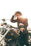 Girl on a motorcycle royalty free stock image