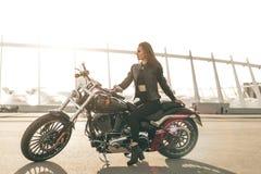 Girl on a motorcycle Stock Photos