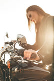 Girl on a motorcycle Stock Image