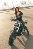 Girl on a motorcycle Stock Images