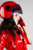 Girl with a motorcycle helmet Stock Images