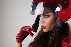 Girl with a motorcycle helmet Stock Photography
