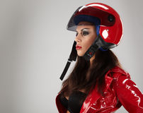 Girl with a motorcycle helmet Royalty Free Stock Images