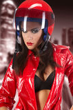 Girl with a motorcycle helmet Royalty Free Stock Photo