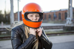 Girl With Motorcycle Helmet Royalty Free Stock Photos