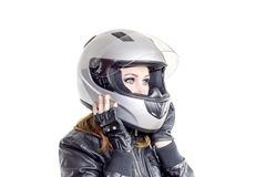 Girl in a motorcycle helmet royalty free stock images