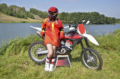 A girl and a motorcycle MX by Lake stock photos