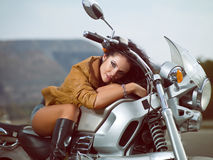Girl on a motorcycle. Photo beautiful girl on a motorcycle on the background of the road and nature Royalty Free Stock Images