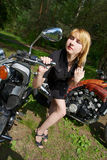 Girl and motorcycles Royalty Free Stock Image