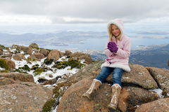 Girl on mountain. A sweet little girl rugged up for winter visiting Mount Wellington in Tasmania Stock Photos