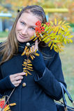 The girl with a mountain ash branch. Stock Photo