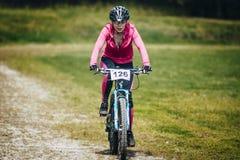 Girl mountain bike completes the race Stock Photos