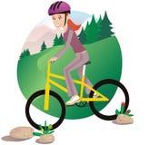 Girl mountain biking Royalty Free Stock Photos