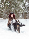 Girl with mountain dog Stock Images
