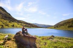 Girl on mountain lake royalty free stock image